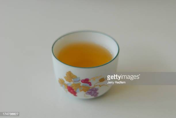 A sample of Oolong tea in a porcelain cup at a tea tasting room in Mae Salong Thailand The local valley was settled by ethnic Chinese allied with the...