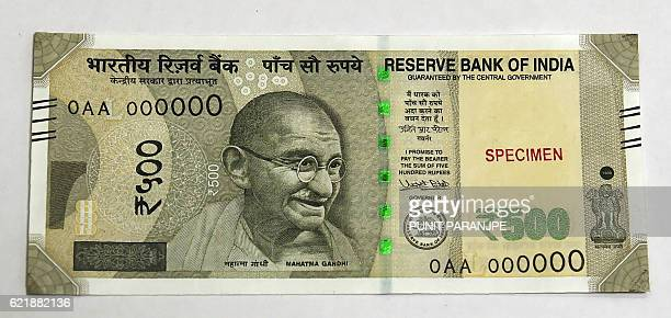 A sample of the new 500 INR note is displayed at the Reserve Bank of India headquarters in Mumbai on November 9 2016 India's government tried to...
