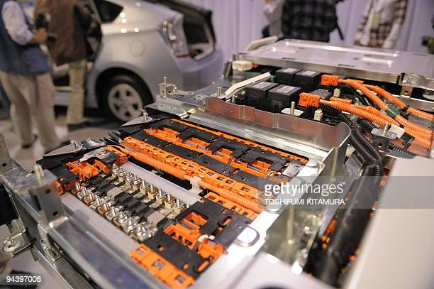 A sample showing the insides of a new lithiumion battery is on display during Toyota Motors' new Prius Plugin Hybrid vehicle press preview at the...