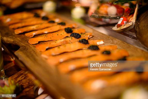 Samples from the menu by Wolfgang Puck and his team of chefs are displayed during the 88th Annual Academy Awards Governors Ball press preview at The...