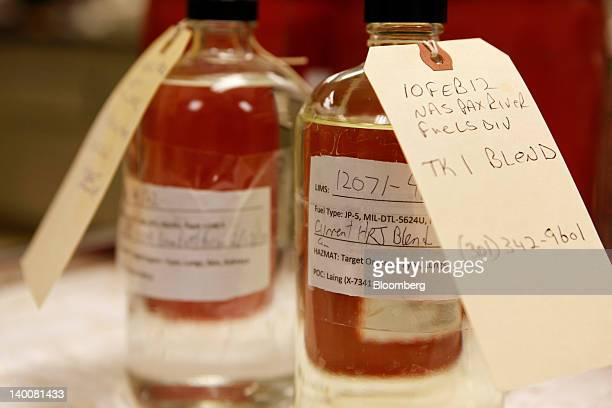 Samples of biofuel sit on a table at the Patuxent River Naval Air Station in Patuxent River Maryland US on Monday Feb 13 2012 The US Navy recently...