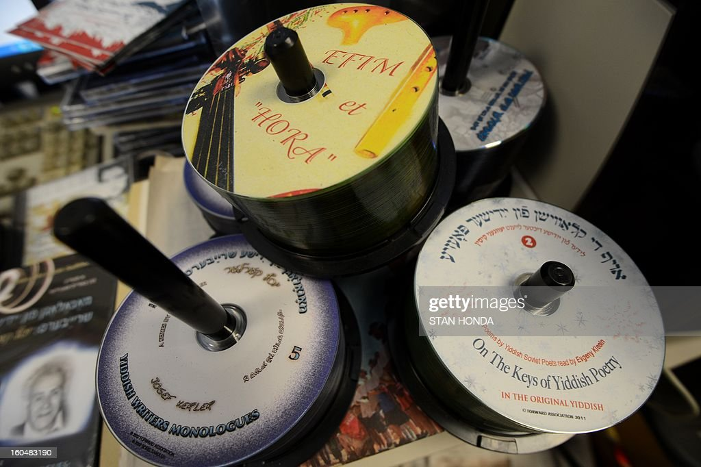 Samples of DVDs in Yiddish produced by the Forward newspaper seen in their office February 1, 2013 in the Lower Manhattan section of New York. A redesigned Yiddish website, part of the 115-year old Jewish newspaper, will be launched on February 4. AFP PHOTO/Stan HONDA