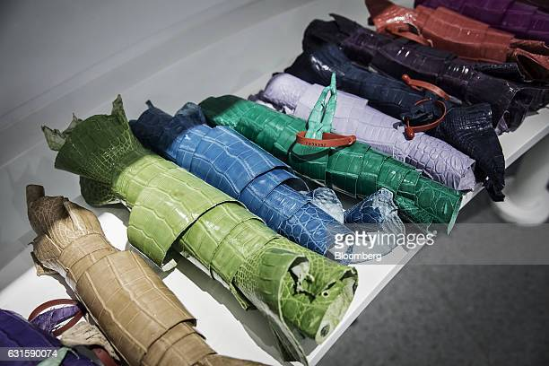 Samples of dyed crocodile leather sit on display in the visitor center at the Chai Tai Saimese Crocodile Breeding Base at a Charoen Pokphand Group Co...