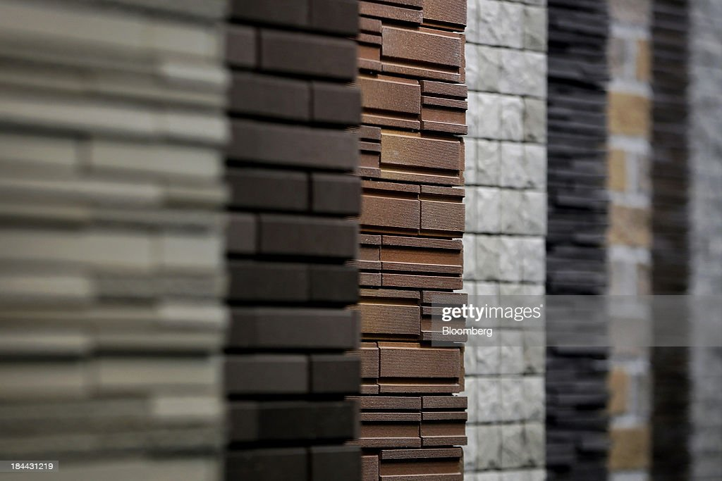 Samples of Lixil Group Corp.'s exterior tiles stand on display at the company's showroom in Tokyo, Japan, on Friday, Oct. 11, 2013. Lixil and Development Bank of Japan agreed on Sept. 26 to buy bathroom-fixtures maker Grohe Group, valuing the German company at 3.06 billion euros ($4.1 billion). Photographer: Kiyoshi Ota/Bloomberg via Getty Images