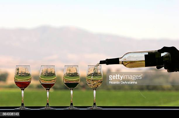Samples of Rose Muscat Cabernet Sauvignon and Pinot Grigio on the window sill at Kalyra winery main tasting room a very popular place owned by an...