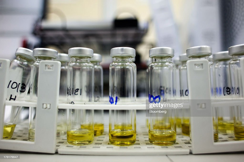 Samples of Spanish olive oil pass through the quality control laboratory at the Carbonell SA plant, operated by Deoleo SA, in Alcolea, Spain, on Tuesday, July 9, 2013. JPMorgan was asked to explore sale of more than 30% stake in olive oil company Deoleo, Reuters reports, citing two people close to the deal. Photographer: Angel Navarrete/Bloomberg via Getty Images