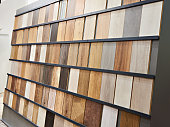 Samples of wooden laminate panels in the building store