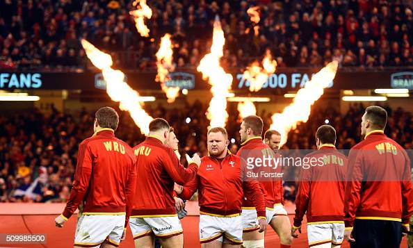Samson Lee and his Wales team mates enter the field before the RBS Six Nations match between Wales and Scotland at Principality Stadium on February...