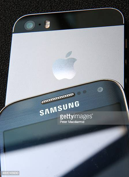 Samsung and Apple smartphone are displayed on August 6 2014 in London England Smartphone and tablet manufacturers Samsung and Apple have agreed to...