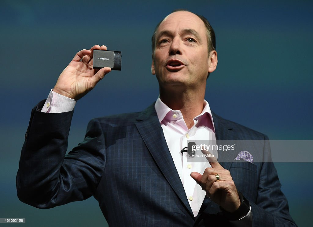 Samsung Electronics America Executive President and Chief Operating Officer Tim Baxter displays an SSD T1 portable solid state drive at a press event...