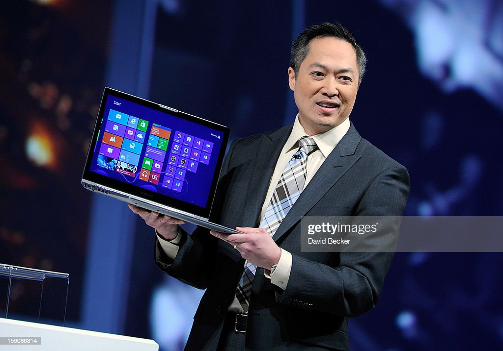 Samsung Electronics America Senior Vice President Michael Abary displays a Samsung Series 9 laptop at a press event at the Mandalay Bay Convention Center for the 2013 International CES on January 7, 2013 in Las Vegas, Nevada. CES, the world's largest annual consumer technology trade show, runs from January 8-11 and is expected to feature 3,100 exhibitors showing off their latest products and services to about 150,000 attendees.