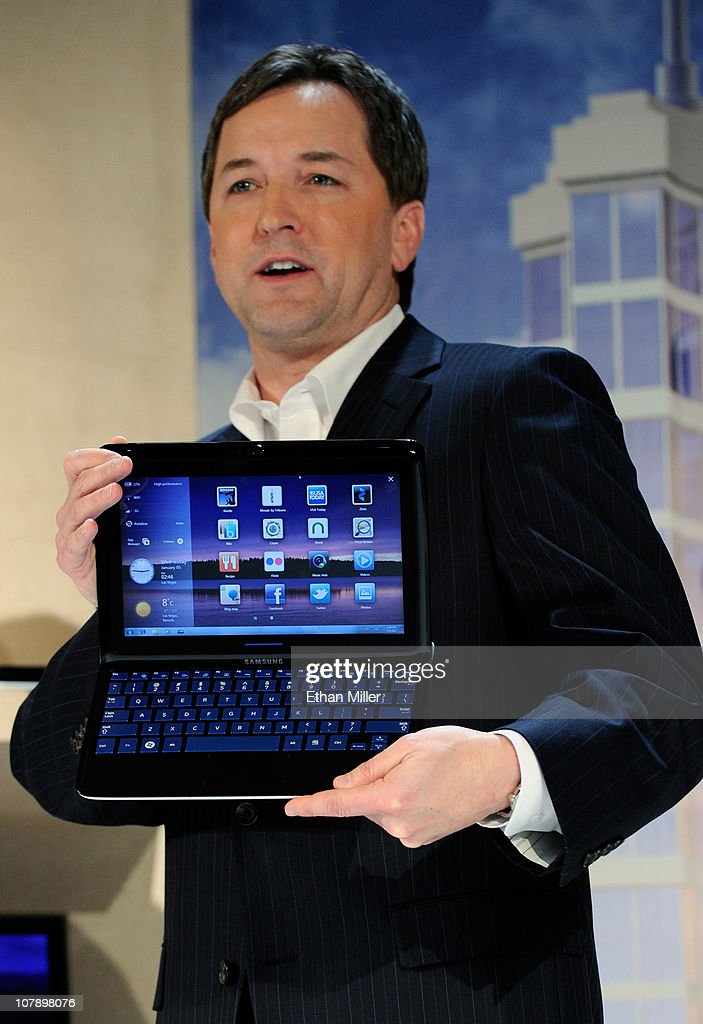Samsung Electronics America's Vice President of Enterprise Business Division Doug Albregts displays the Samsung 7 Series Sliding PC featuring a keyboard that slides out of a tablet design during a press event at the 2011 International Consumer Electronics Show at the Venetian January 5, 2011 in Las Vegas, Nevada. CES, the world's largest annual consumer technology trade show, runs from January 6-9 and is expected to feature 2,700 exhibitors showing off their latest products and services to about 126,000 attendees.