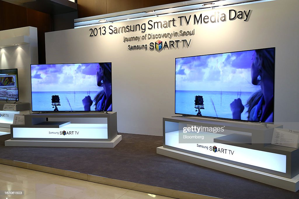 Samsung Electronics Co. F8000 series smart televisions are displayed at a media event in Seoul, South Korea, on Tuesday, Feb. 19, 2013. Samsung Electronics Co., the world's largest television maker, targets to start selling TVs using a technology allowing brighter and sharper images in the first half to extend its market lead. Photographer: SeongJoon Cho/Bloomberg via Getty Images
