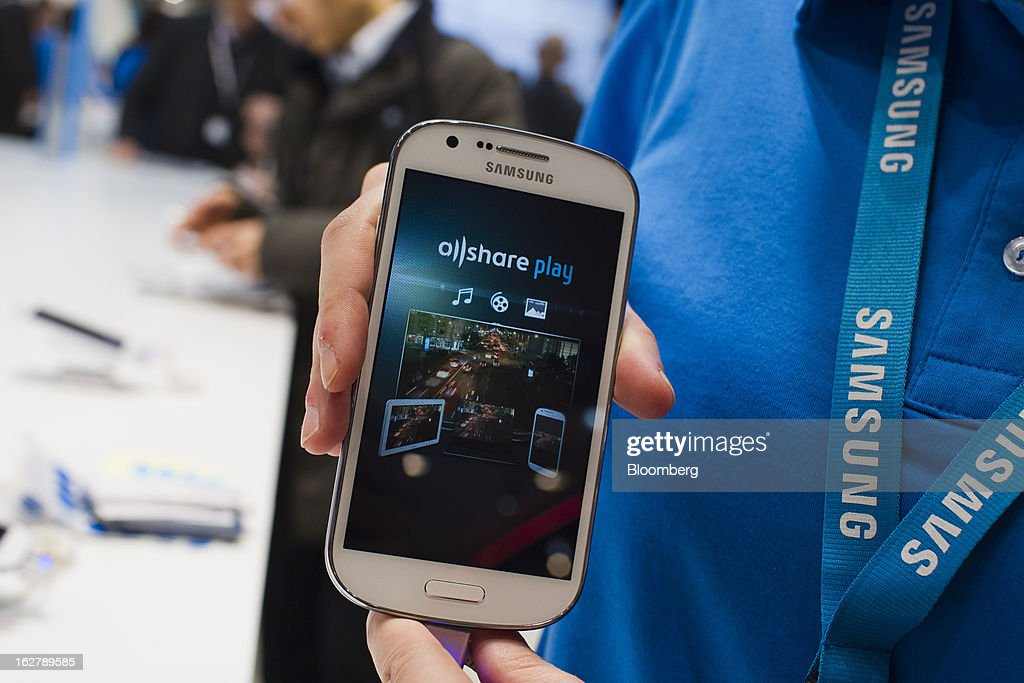 A Samsung Electronics Co. Galaxy Express smartphone is displayed for a photograph at the Mobile World Congress in Barcelona, Spain, on Wednesday, Feb. 27, 2013. The Mobile World Congress, where 1,500 exhibitors converge to discuss the future of wireless communication, is a global showcase for the mobile technology industry and runs from Feb. 25 through Feb. 28. Photographer: Angel Navarrete/Bloomberg via Getty Images