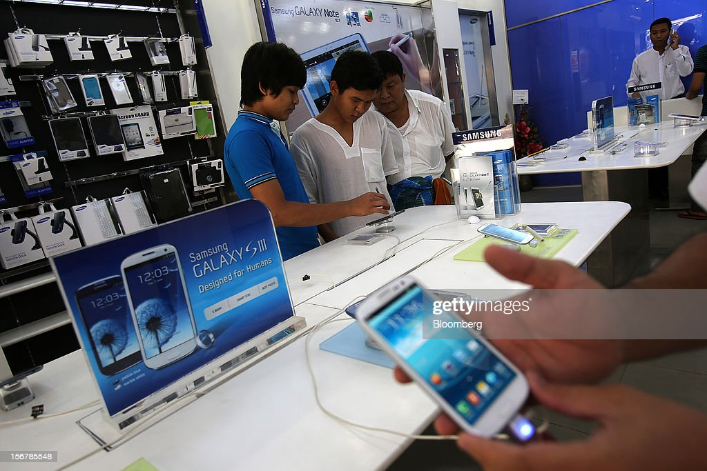 Samsung Electronics Co. Galaxy S III smartphones are displayed for sale at the company's retail store in Yangon, Myanmar, on Tuesday, Nov. 20, 2012. Myanmar's growth outlook has improved 'substantially' amid political reforms, which are expected to lead to a large influx of foreign investment, the Organization for Economic Cooperation and Development (OECD) said on Nov. 18. Photographer: Dario Pignatelli/Bloomberg via Getty Images