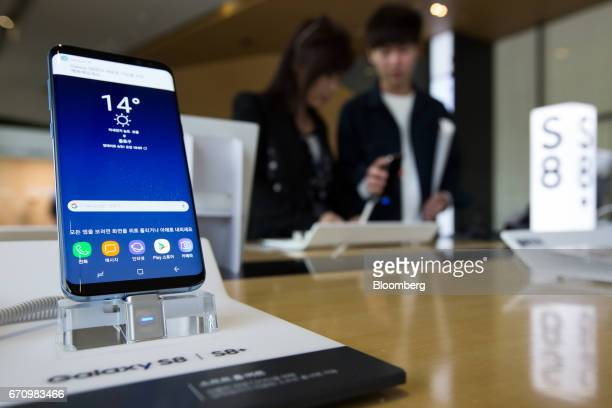 A Samsung Electronics Co Galaxy S8 smartphone is displayed at KT Corp's Olleh Square flagship store in Seoul South Korea on Friday April 21 2017...