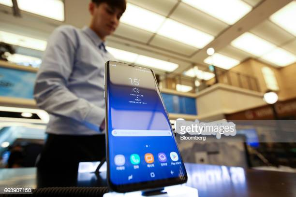 A Samsung Electronics Co Galaxy S8 smartphone is displayed at one of the company's promotional booths in Seoul South Korea on Sunday April 2 2017 The...