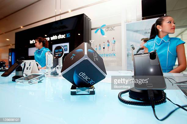 A Samsung Electronics Co Galaxy smartphone right sits on a counter at a Total Access Communication Pcl exhibition stand at the company's headquarters...
