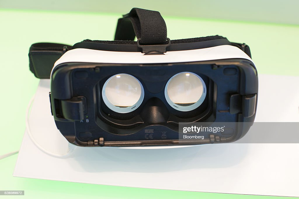 A Samsung Electronics Co. Gear VR virtual reality headset sits on display inside a Royal KPN NV mobile phone store in Nijmegen, Netherlands, on Friday, May 6, 2016. Carlos Slim's America Movil SAB is considering the sale of its minority stake in Dutch phone company KPN, less than three years after the Mexican billionaire's failed takeover attempt, according to people with knowledge of the matter. Photographer: Jasper Juinen/Bloomberg via Getty Images