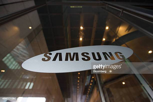 Samsung Electronics Co logo is displayed at the company's Seocho office building in Seoul South Korea on Friday March 14 2014 in Seoul South Korea on...