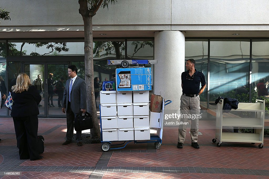Samsung Electronics Co. representatives wait to enter the Robert F. Peckham Federal Courthouse on July 30, 2012 in San Jose, California. The trial in the Apple Inc. and Samsung Electronics Co. patent battle begins today at a San Jose federal courthouse to determine if Samsung illegally copied technolgy used in Apple's popular iPhone and iPads. Apple is seeking $2.5 billion in damages.