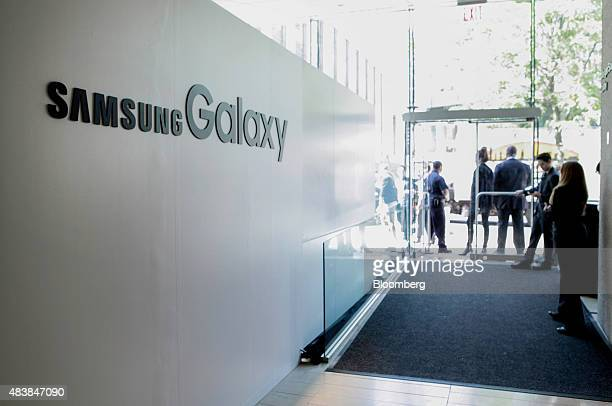 Samsung Electronics Co signage is displayed as attendees wait to enter Unpacked 2015 event in New York US on Thursday Aug 13 2015 Samsung will get...