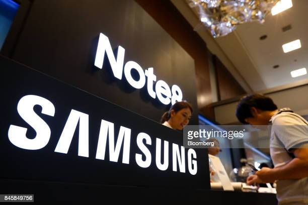 Samsung Electronics Co signage is displayed at a media event for the Galaxy Note 8 smartphone in Seoul South Korea on Tuesday Sept 12 2017 Samsung's...