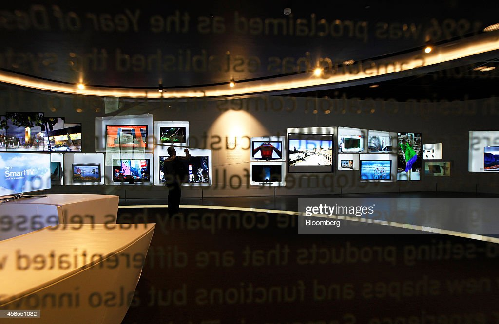 Samsung Electronics Co television screens are seen through a glass panel in an exhibition hall at the Samsung Innovation Museum in Suwon South Korea...