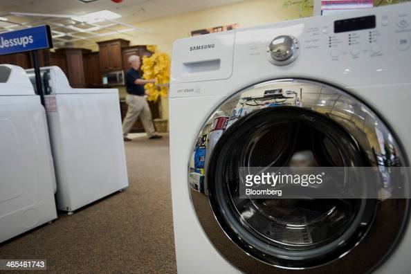 A Samsung Electronics Co washing machine is displayed for sale in rows at the Jessup's Appliances store in Sarasota Florida US on Friday Jan 24 2014...