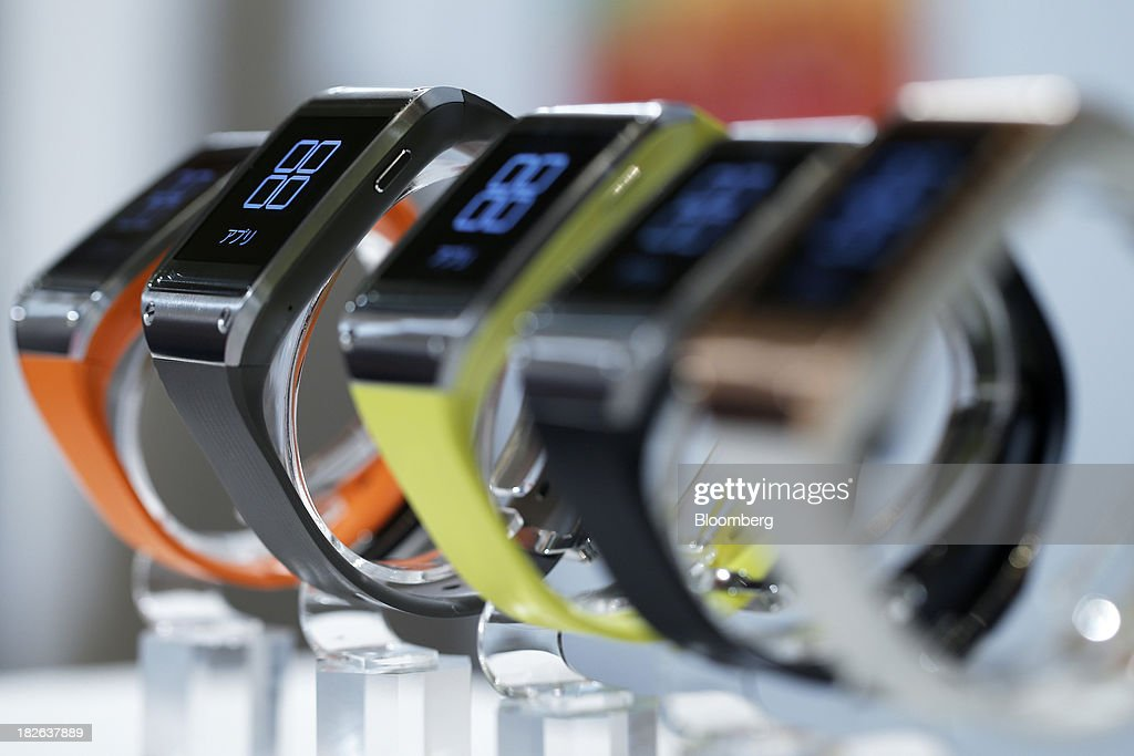 Samsung Electronics Co's Galaxy Gear wearable devices for KDDI Corp's 'au' brand sit on display during a product launch event in Tokyo Japan on...