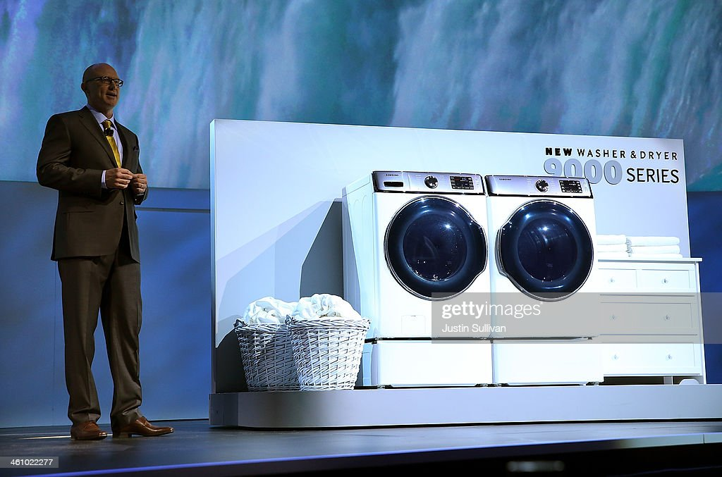 Samsung Electronics Senior Vice President Kevin Dexter announces the new Samsung 9000 series washer and dryer during a press event at the Mandalay...