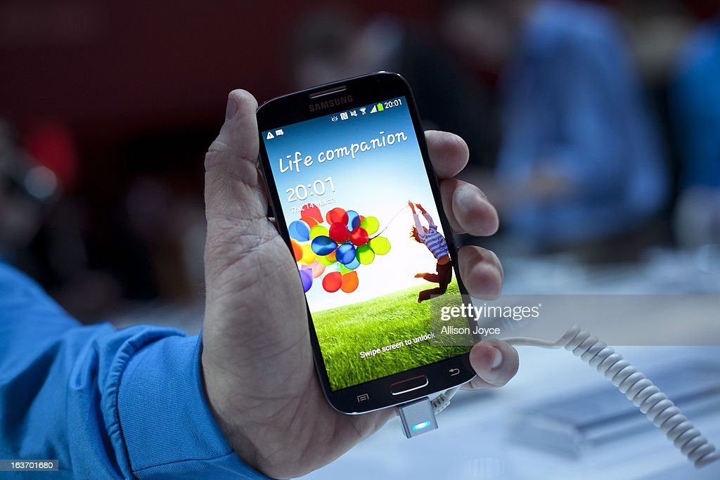 A Samsung employee displays the Samsung Galaxy S IV for a photo March 14, 2013 in New York City. Samsung, the world's largest handset maker, revealed their successor to the Galaxy S III. The Galaxy S IV features a five-inch 1080p screen, a 1.9GHz quad-core processor, a 13-megapixel rear camera and ships with the latest Android version, Jelly Bean.