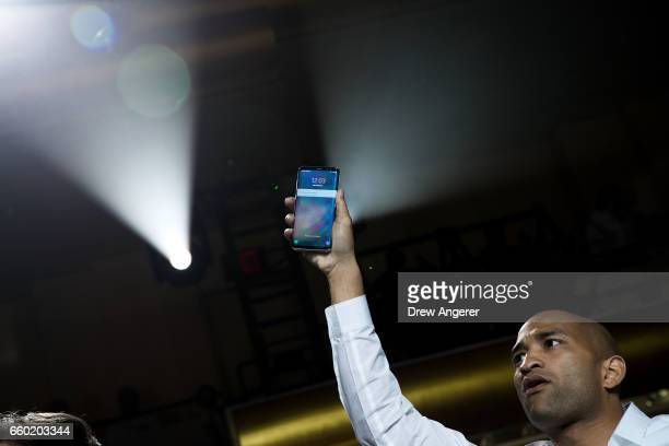 Samsung employee holds up a Samsung Galaxy S8 at the conclusion of a launch event for the new Samsung Galaxy S8 March 29 2017 in New York City...