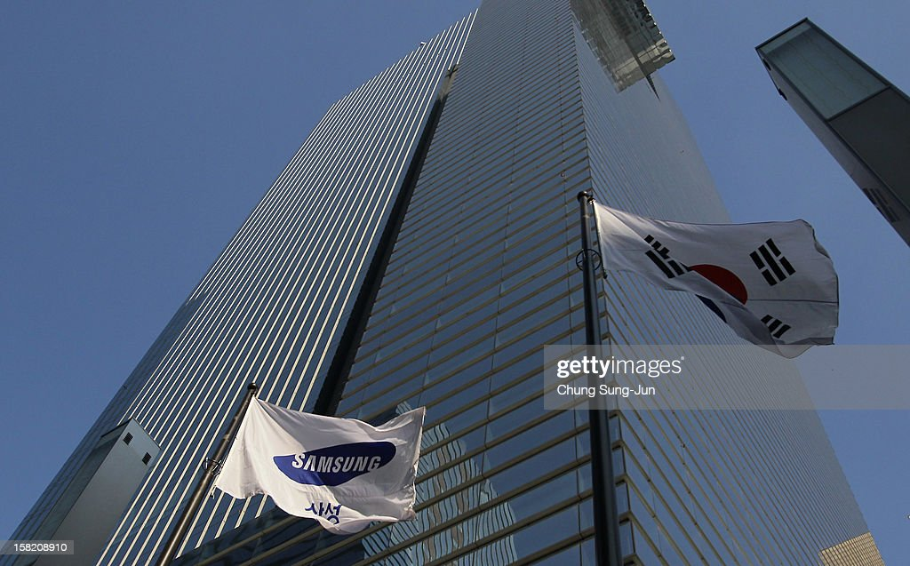 A Samsung flag flies outside the company's headquarters on December 11, 2012 in Seoul, South Korea. One of the main South Korean presidential election campaign issues is the economy, as the chaebol, South Korea's business conglomerate, dominates the country's wealth while the economic life of middle class people has not been improving.