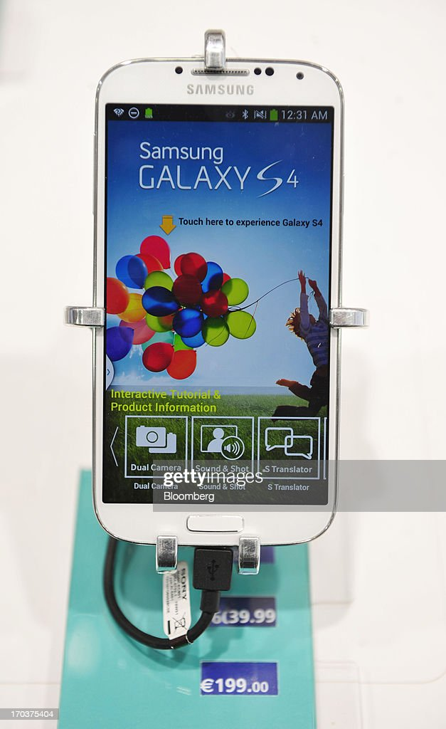 A Samsung Galaxy S4 smart phone sits in a stand inside an O2 Mobile Phone Store, part of Telefonica SA, on Grafton Street in Dublin, Ireland, on Wednesday, June 12, 2013. Telefonica SA, Europe's most indebted telephone company, is seeking initial bids for its Irish unit within the month, two people with knowledge of the matter said. Photographer: Aidan Crawley/Bloomberg via Getty Images