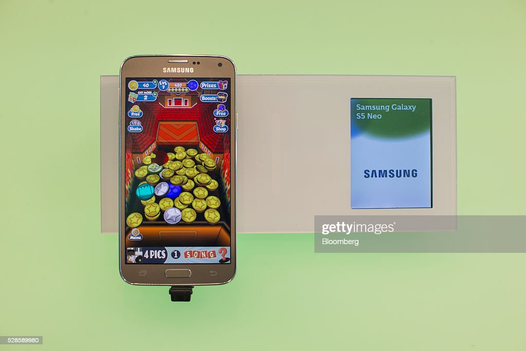 A Samsung Galaxy S5 Neo smartphone, manufactured by Samsung Electronics Co., sits on display inside a Royal KPN NV mobile phone store in Nijmegen, Netherlands, on Friday, May 6, 2016. Carlos Slim's America Movil SAB is considering the sale of its minority stake in Dutch phone company KPN, less than three years after the Mexican billionaire's failed takeover attempt, according to people with knowledge of the matter. Photographer: Jasper Juinen/Bloomberg via Getty Images