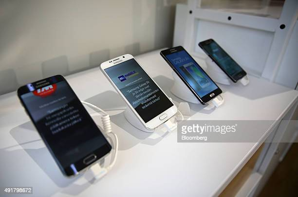 Samsung Galaxy S6 Edge S6 A5 and A3 smartphones sit on display inside a Telekom Srbija AD mobile phone store in Belgrade Serbia on Wednesday Oct 7...