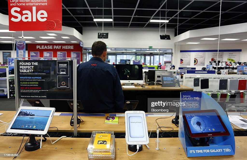 Samsung Galaxy tablet computers, manufactured by Samsung Electronics Co., are displayed inside a Currys and PC World 2 in 1 store, operated by Dixons Retail Plc, in Manchester, U.K., on Tuesday, June 18, 2013. Dixons Retail Plc, the U.K.'s largest consumer-electronics retailer, said last month it will report annual pretax profit at the 'top end' of analysts' predictions after fourth-quarter revenue beat estimates on increased sales of tablets and services such as software tutorials. Photographer: Paul Thomas/Bloomberg via Getty Images