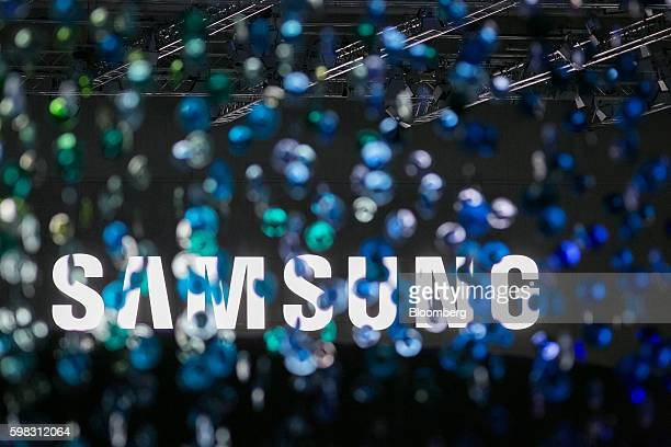 A Samsung logo stands illuminated during a news conference on the Samsung Electronics Co exhibition stand during the IFA International Consumer...