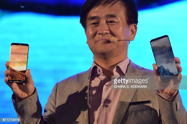 Samsung Managing Director of Samsung Sri Lanka Youngmin Shin displays a Samsung Galaxy S8 smartphone during the ceremony to launch the phone in...
