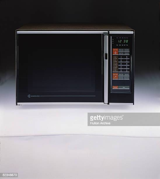 A Samsung microwave oven features a numeric keypad and a digital display screen 1970s