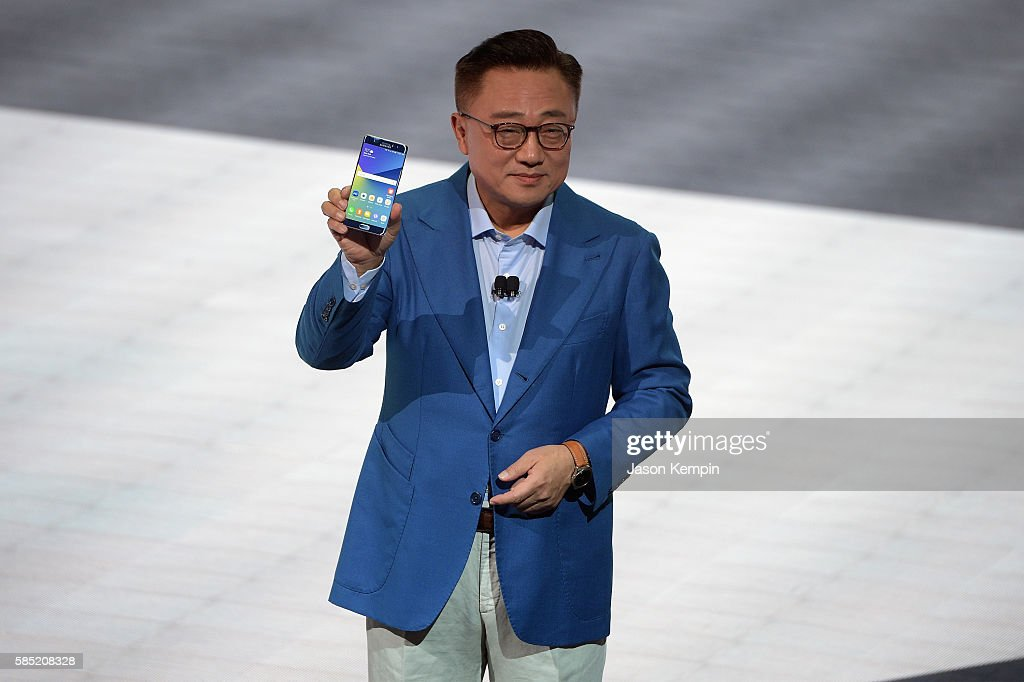 Samsung President of Mobile Communications Business DJ Koh speaks onstage holding the new Samsung Galaxy Note 7 during Samsung Unpacked 2016 at...
