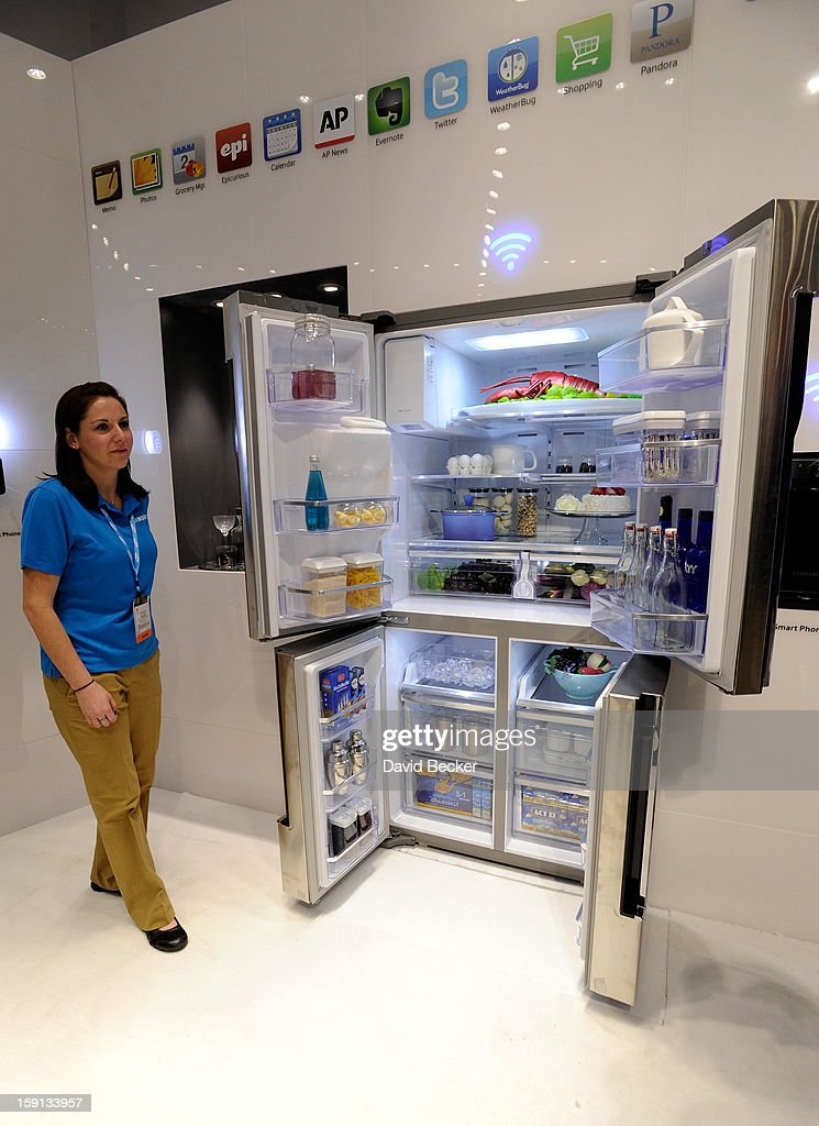 Samsung representative Lindsey Hughes stands by Samsung's T9000 WiFi enabled refrigerator at the 2013 International CES at the Las Vegas Convention Center on January 8, 2013 in Las Vegas, Nevada. CES, the world's largest annual consumer technology trade show, runs through January 11 and is expected to feature 3,100 exhibitors showing off their latest products and services to about 150,000 attendees.