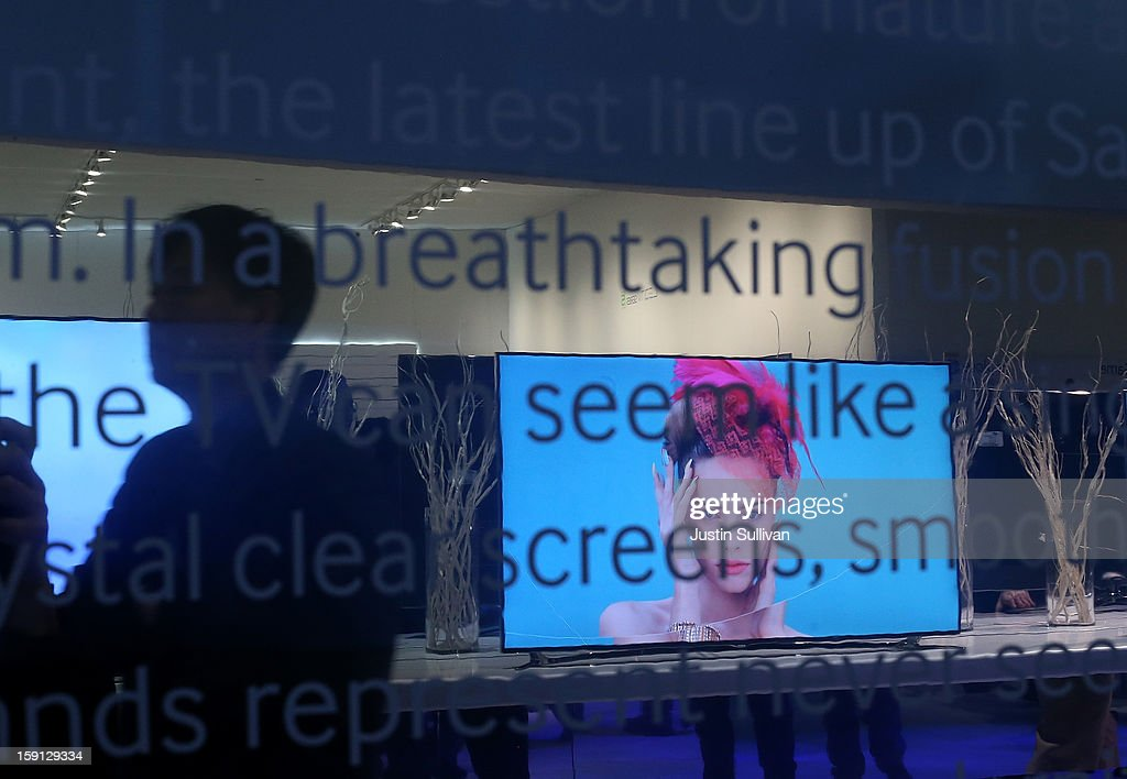 A Samsung television is seen reflected in a mirror during the 2013 International CES at the Las Vegas Convention Center on January 8, 2013 in Las Vegas, Nevada. CES, the world's largest annual consumer technology trade show, runs from January 8-11 and is expected to feature 3,100 exhibitors showing off their latest products and services to about 150,000 attendees.