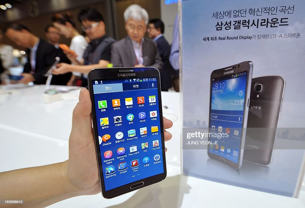 Samsung's first 'curved' smartphone Galaxy Round, a 5.7-inch handset with a display that is slightly rounded on both sides, is seen at the Electronics and IT Industry Fair in Goyang, north of Seoul, on October 10, 2013. Samsung's first smartphone with a curved display screen enters the South Korean market on October 10, as the electronics giant seeks to maintain its lead in the increasingly saturated market.