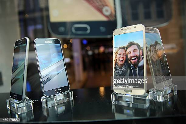 Samsung's latest flagship smartphones the Galaxy S6 and the S6 Edge are viewed in the window of a Samsung store on the day of their release on April...