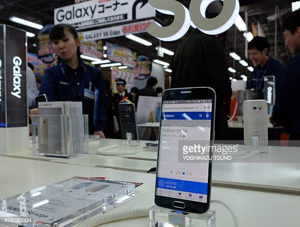 Samsung's new smartphone 'Galaxy S6 edge' is displayed at a shop in Tokyo on April 18 2015 The S6 will go on sale in Japan on April 23 Samsung has...