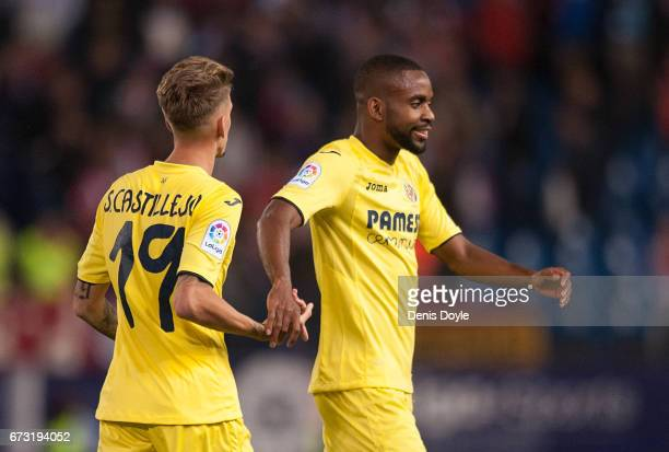 Samu Castillejo and Cedric Bakambu of Villarreal CF celebrate after beating Club Atletico de Madrid 10 in the La Liga match between Club Atletico de...