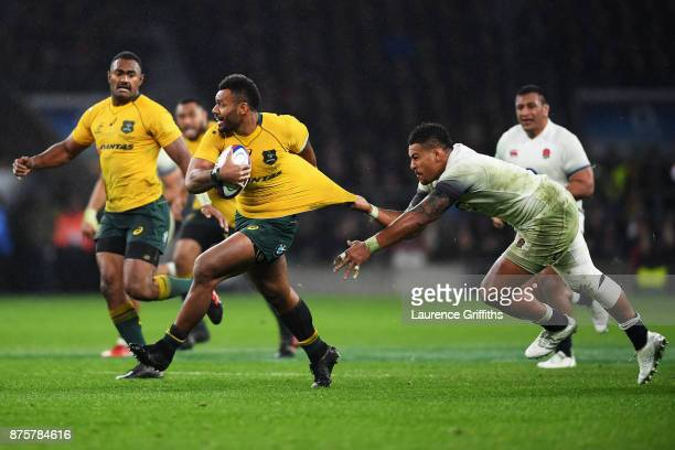 Samu Kerevi of Australia attempts to challenged by Nathan Hughes of England during the Old Mutual Wealth Series match between England and Australia...