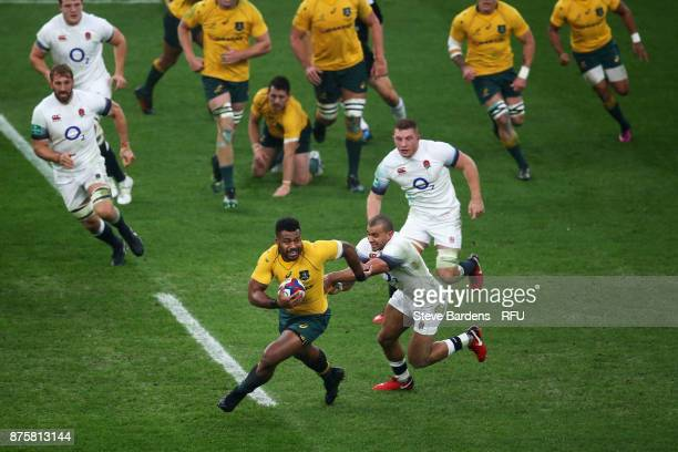 Samu Kerevi of Australia is challenged by Jonathan Joseph of England during the Old Mutual Wealth Series match between England and Australia at...